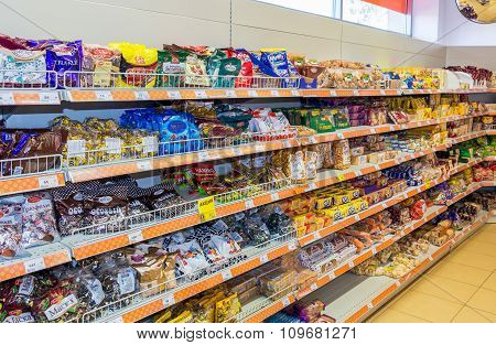 Sale Of Sweets, Chocolates And Cookies At The Grocery Store Dixy