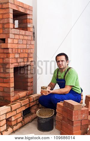 Man Building A Masonry Heater