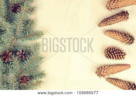 Branches Of Blue Spruce And Cones On A Wooden Background