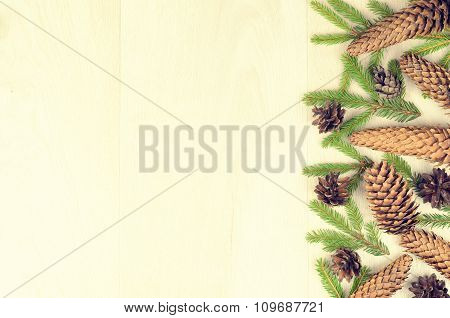 Branches Of Spruce And Fir Cones On A Wooden Background