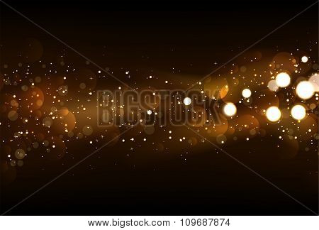 Defocused Glitter Lights Background In Dark Gold And Black Colors.
