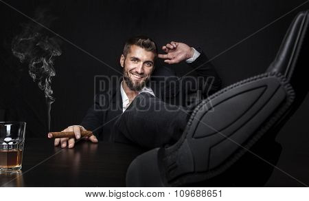 Businessman enjoying the closing time,