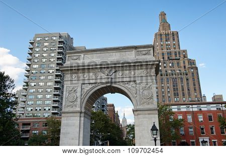 Low Angle View of Washington Square Arch on Northern Edge of Washington Square Park with View of Highrise Buildings in Background, Greenwich Village, Manhatten, New York City, New York, USA