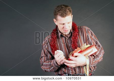 A Man Opens A Gift