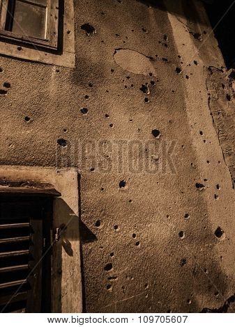 Gun shot holes on a gray concrete building in Sarajevo Bosnia and Herzegovina Europe. poster