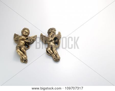 Two Cherubs On White Background