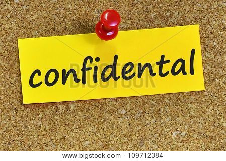 Confidental Word On Yellow Notepaper With Cork Background