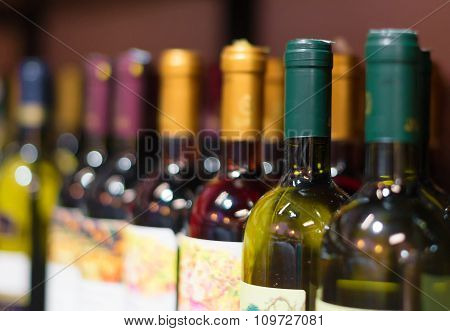 Wine bottles row in the wine store.
