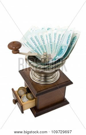 Depreciation Of Money - Brown Grinder With Russian Money On A White Background.