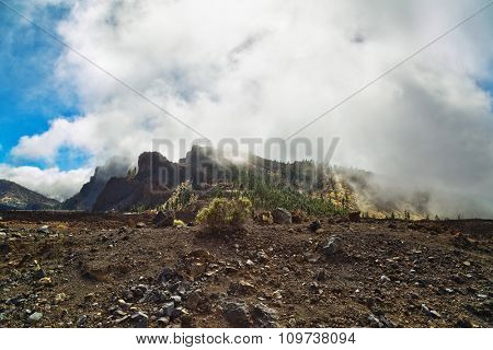 Landscape with mountains covered with clouds in the Teide National Park at Tenerife, Canary Islands, Spain