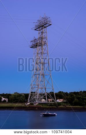 High tension power tower at sunset