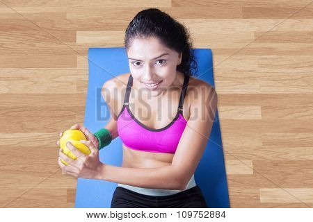 Woman Exercise On Mattress With Dumbbell