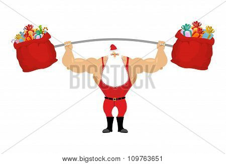 Strong Santa Claus Holding Barbell And Gift Bag. Sports For Christmas Santa With Beard. Red Bag With