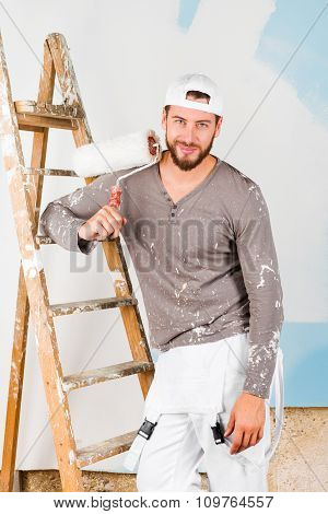 Smiling Handsome Painter With Paint Brush