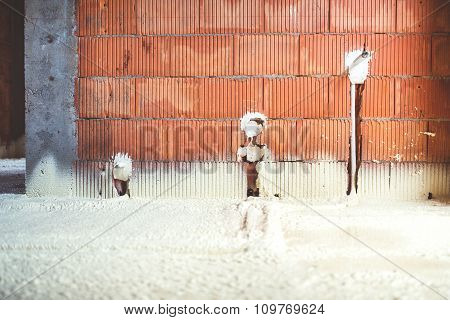 Thermo Insulation With Spray Foam, Brick Walls And Electricity Lines At Construction Site