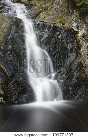 A waterfall in a mountain creek in the High Fens Ardennes Belgium long exposure shot poster