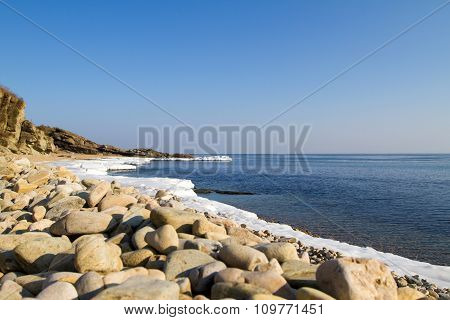 Sea stones on the beach of winter.