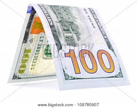 Native dollar folded in half, money hut, currency angle isolated