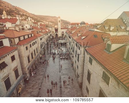 Aerial view of old city of Dubrovnik (Croatia) above Stradun street, popular tourist attraction on Adriatic. Post processed with vintage filter.