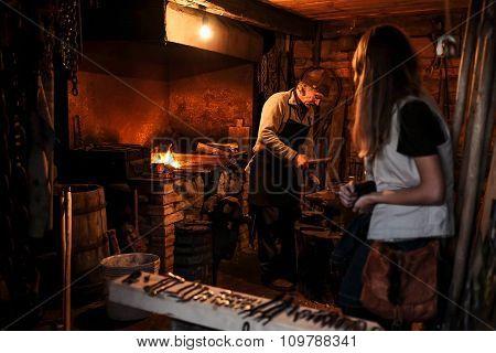 Ligatne, Latvia - October 3, 2015: Farrier at work in a vintage forge