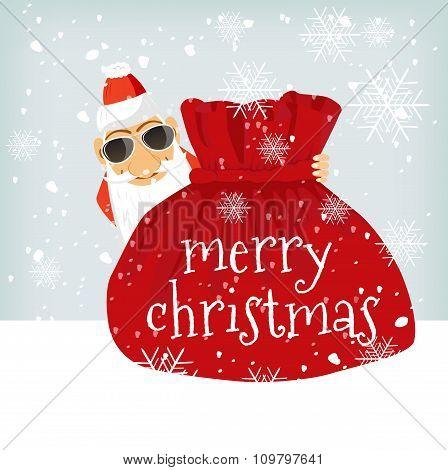 Santa Claus standing near Christmas bag