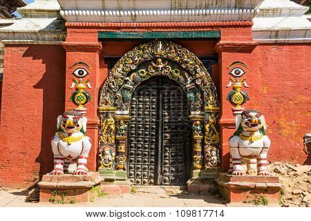 Temple gate guarded by deities.