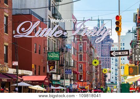 NEW YORK CITY USA - AUGUST 21 2015: The busy streets of Little Italy are crowded with tourists during an Italian summer street festival in Manhattan New York City.