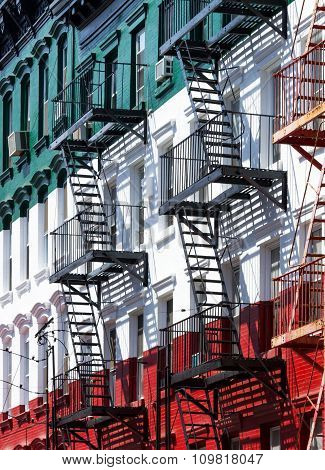 Block of painted apartment buildings in Little Italy in Manhattan New York City