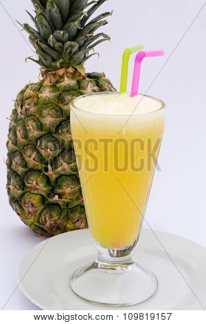 Pineaple juice with fresh pineapple isolated on white