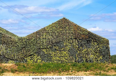 RYAZAN REGION  -   AUGUST 3:Camouflaged military screening netting at the army training camp   -  August 3, 2015 in Ryazan region