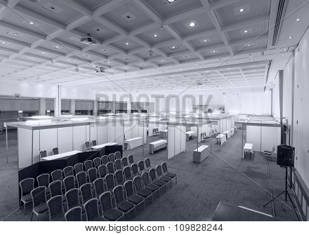Trade show interior with booth and tables