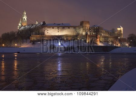 Poland Krakow Wawel Royal Castle Lit-up winter evening seen from the west poster