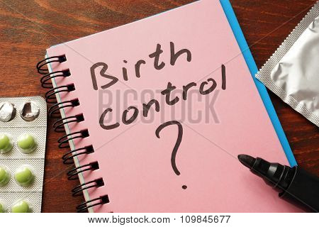 Notebook with the words  Birth control.