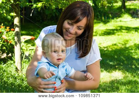 Charming Caucasian Baby Boy With Mother
