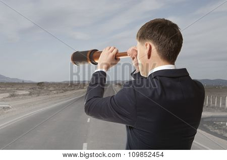 Business concept. Businessman looks through a telescope  poster