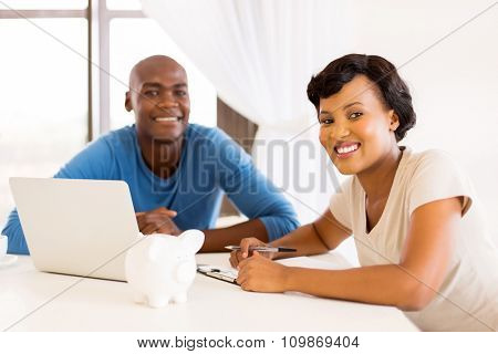 smart young african couple  doing their financials or paying bills