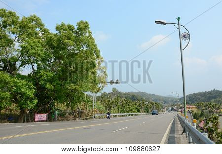 Rural Scenery With Road At Countryside