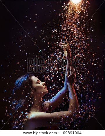 Beautiful brunette over sparkly particles background