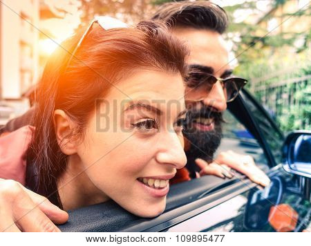 Hipster Couple Looking Outside From Their Cabrio - Love,fashion, Hipster And New Future Concept