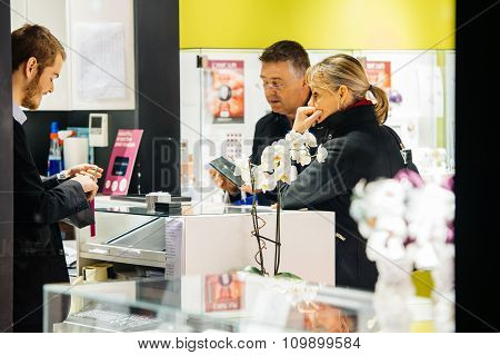 Couple Buying Jewlery In Luxury Boutique