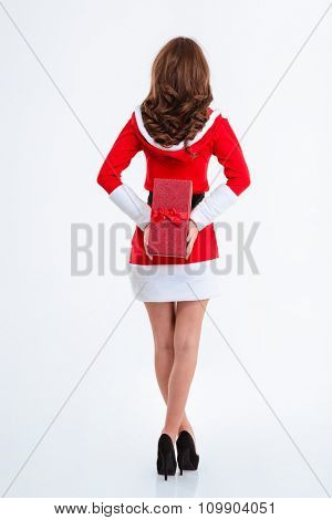 Back view portrait of a woman in santa claus cloth holding gift box isolated on a white background