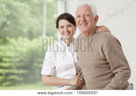Woman Caring For Old Man