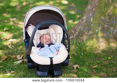 Newborn Baby Boy Sleeping In Car Seat
