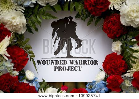 NEW YORK - NOVEMBER 11 2015: A wreath from the Wounded Warrior Project at the Eternal Light Monument for the ceremony in Madison Square Park before the Americas Parade up 5th Avenue on Veterans Day.