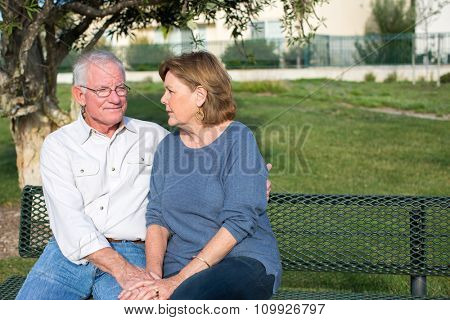 Senior couple having a serious discussion outside