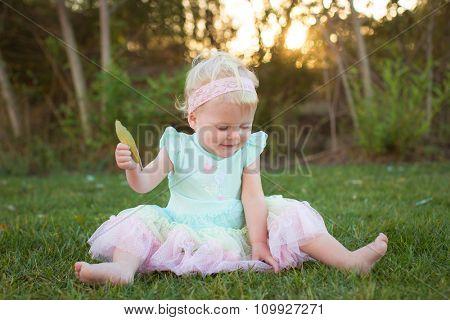 Cute little girl wearing a tutu in the grass