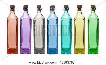 colorful glass bottles on isolated white background