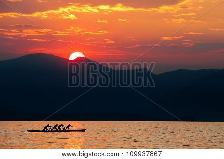 Rowing Team At Sunset.