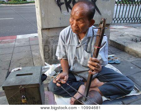 Elderly Thai blind man, Bangkok, Thailand.