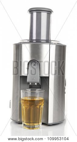 Stainless juice extractor with glass of juice isolated on white background